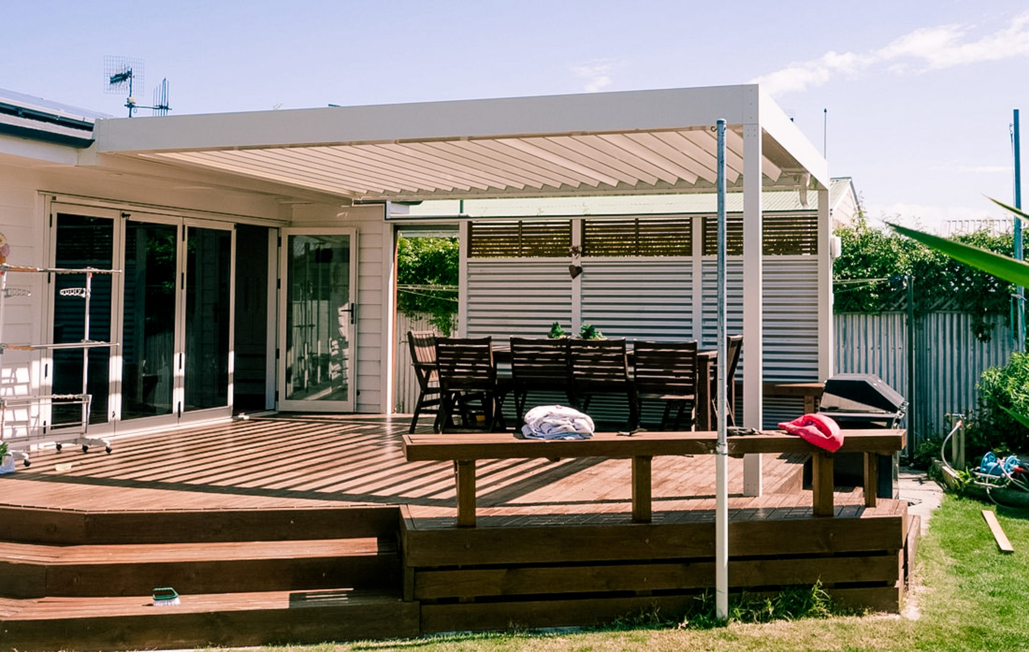 all white louvre roof with blades open covering a deck on a taradale home in napier new zealand